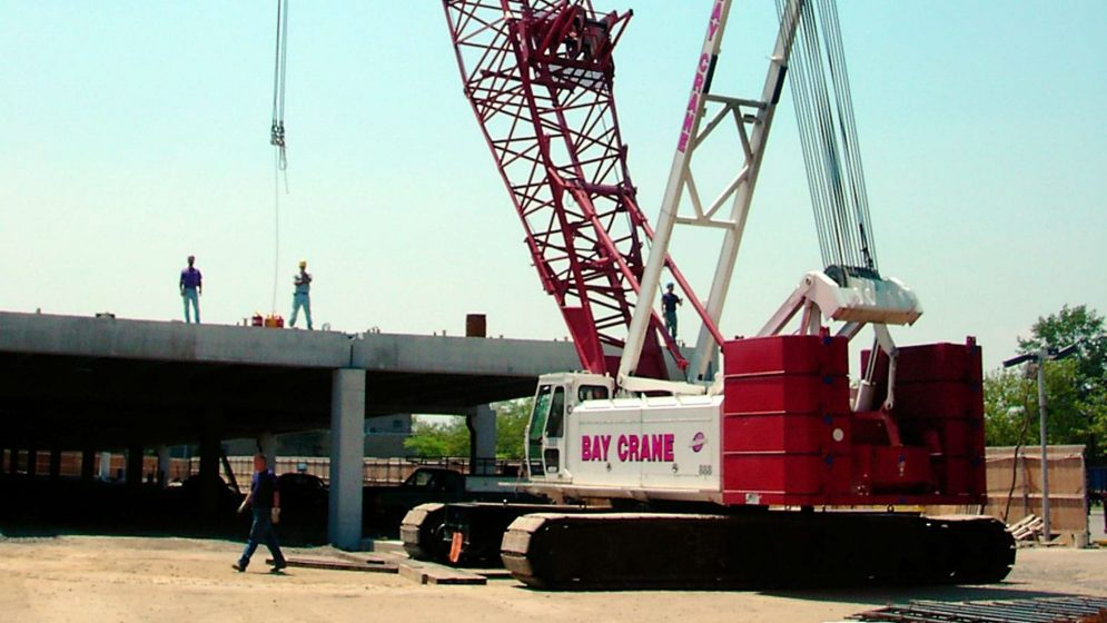 888 crawler crane on site with Bay Crane employees