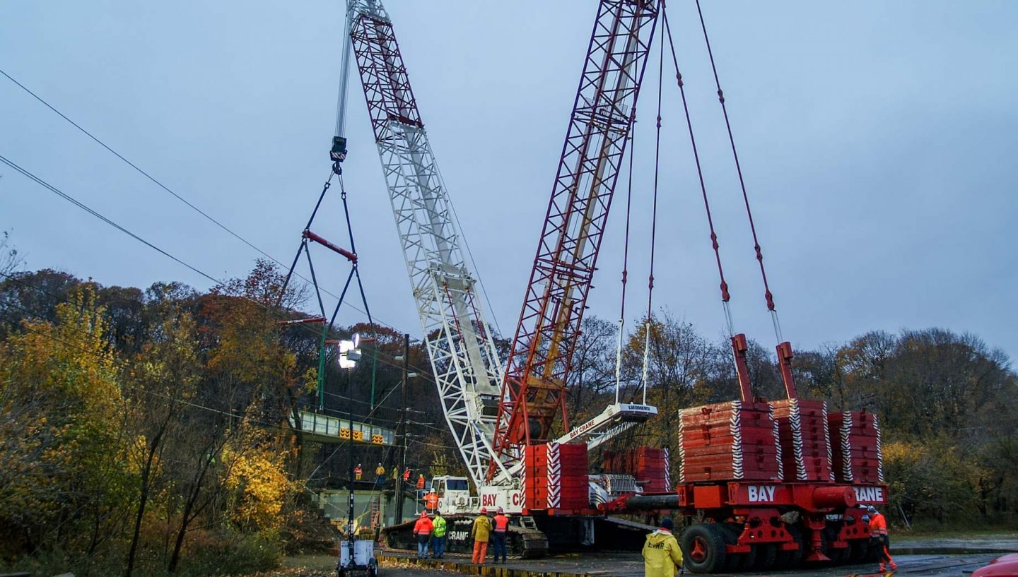 Cranes lifting heavy equipment