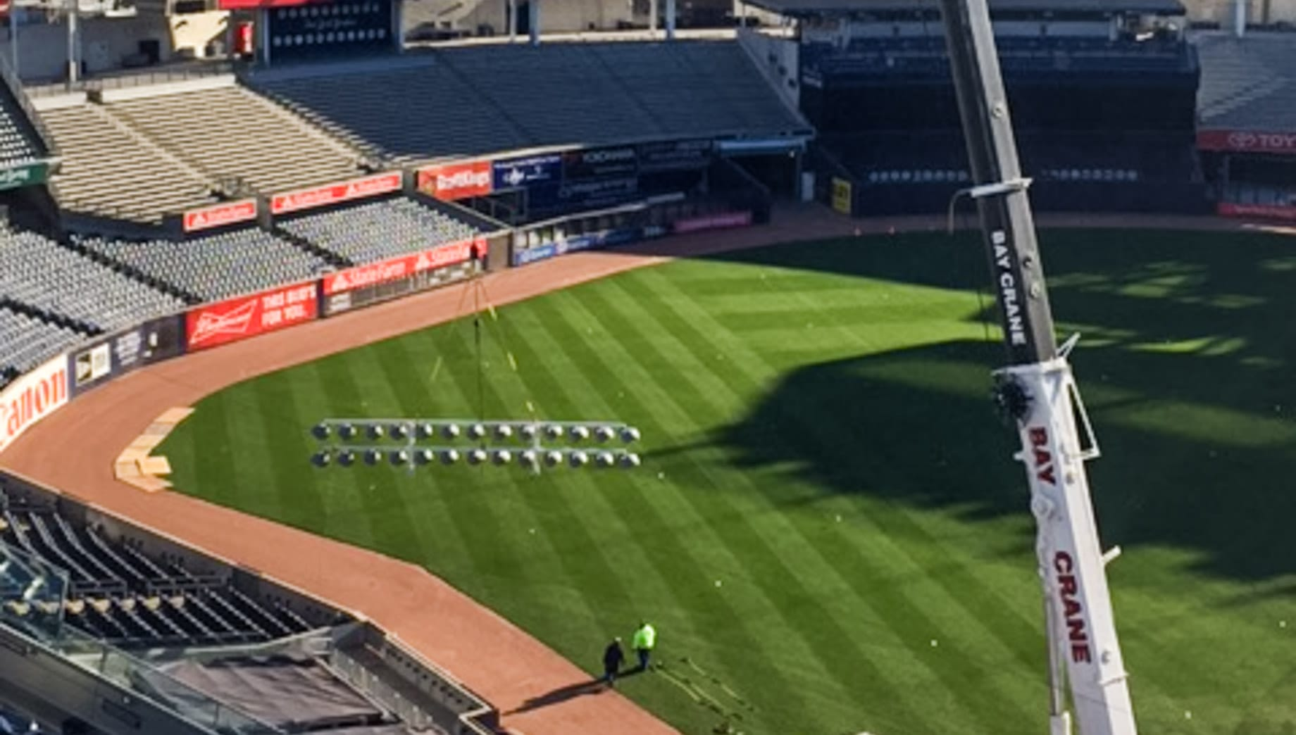 Crane lifting lights in Yankee Stadium