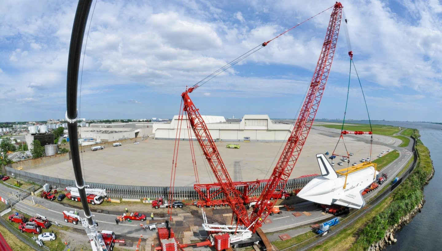 Crane lifting space shuttle