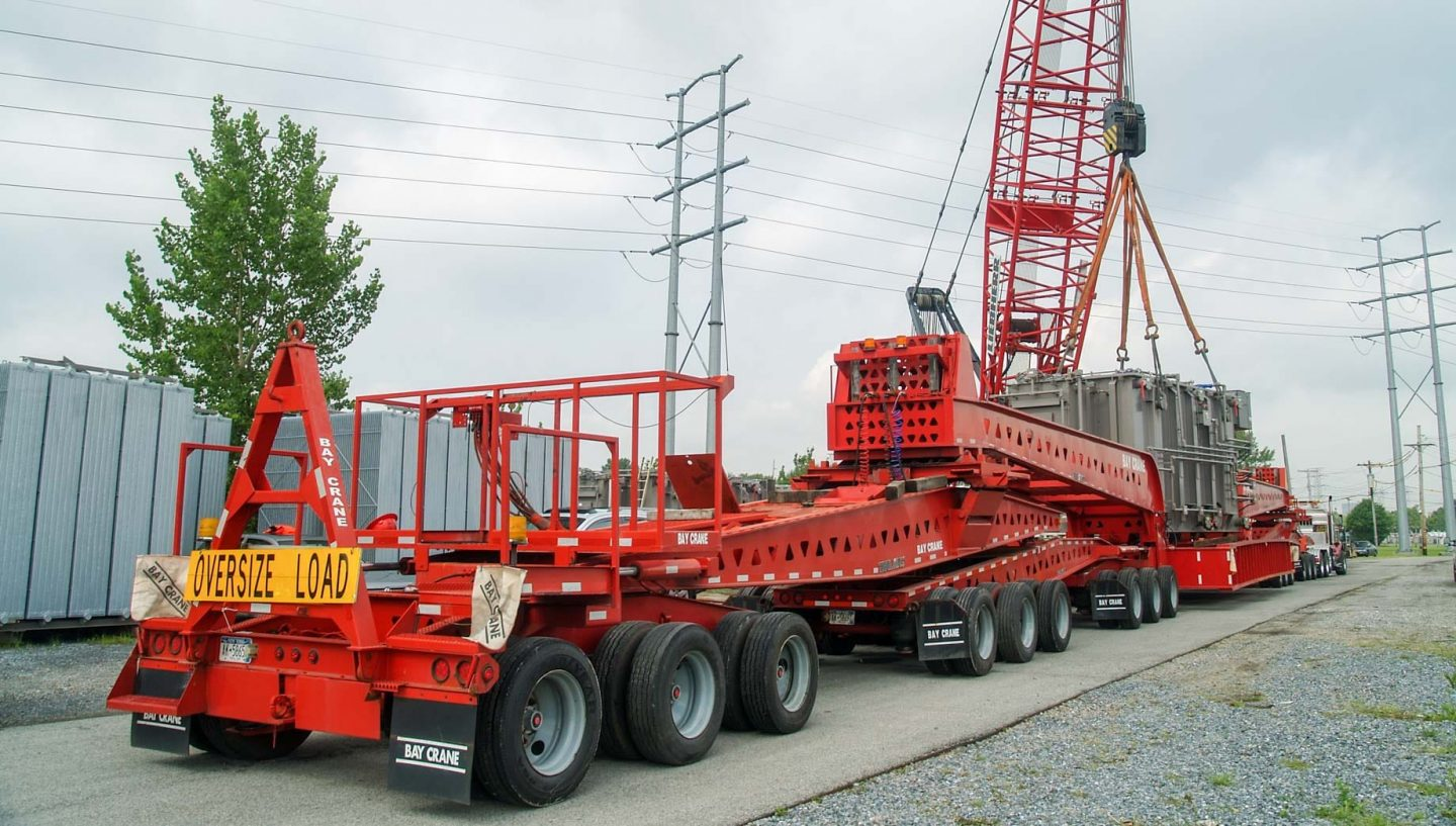 Crane placing equipment on truck