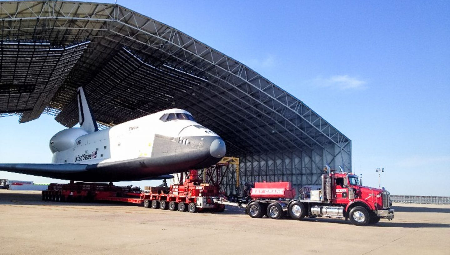 Truck transporting space shuttle from hangar
